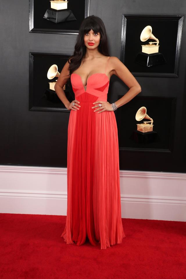 Jameela Jamil wore a floor-length, two tone gown with plunge neckline by J. Mendel