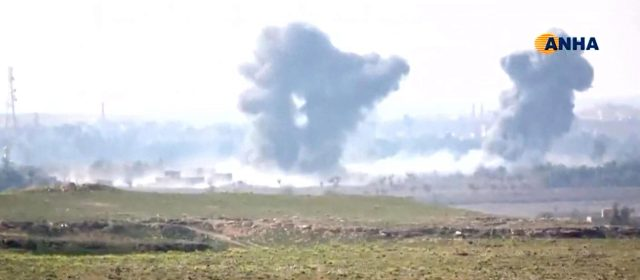 Black plumes of smoke rise above the battle zone in and around the village of Baghouz