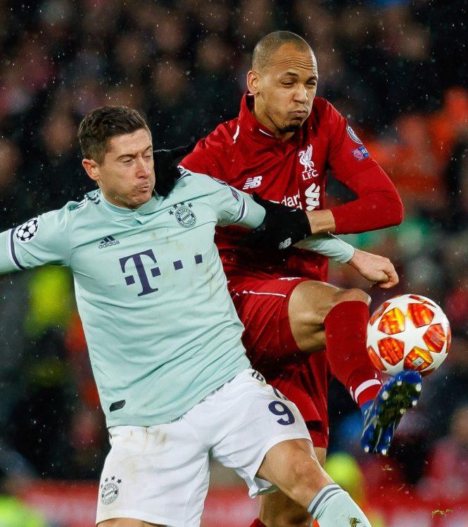 Fabinho gets to grips with Bayern's striking legend Robert Lewandowski but it was still Jordan Henderson who was the key influence for the Reds