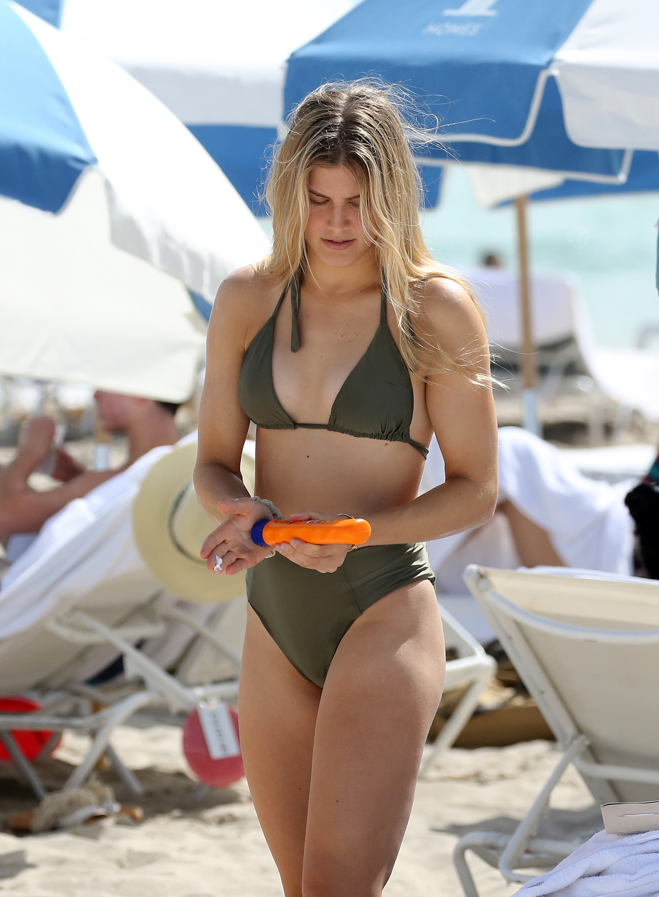 Bouchard needed help with her cream on Miami beach, where the heat was on...