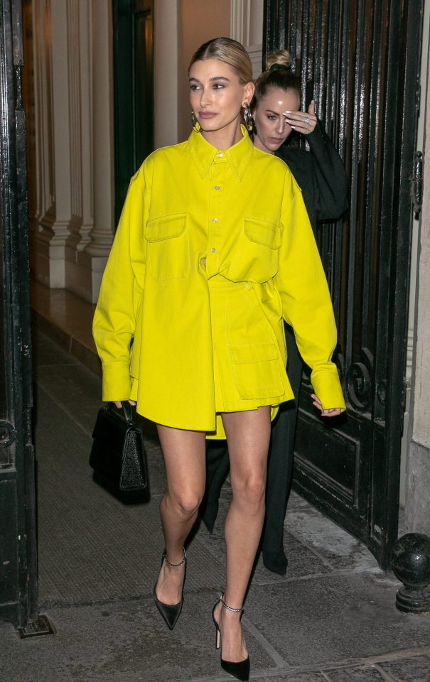 Hailey Bieber looks like she raided hubby Justin's wardrobe as she steps out in an oversize shirt-jacket