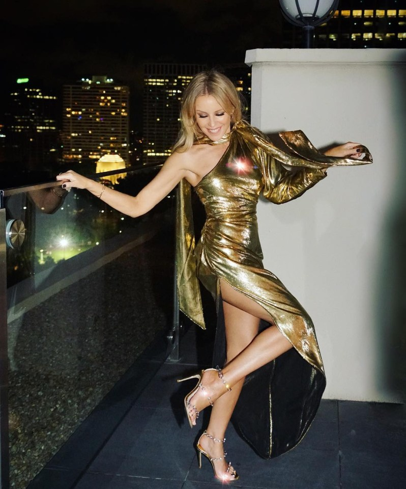 Kylie looked sensational in a metallic dress as she posed on the balcony of her hotel in Sydney ahead of her first of two gigs in the city