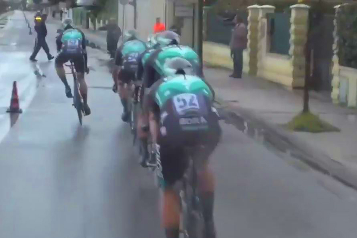 The riders were going at high speed on wet roads