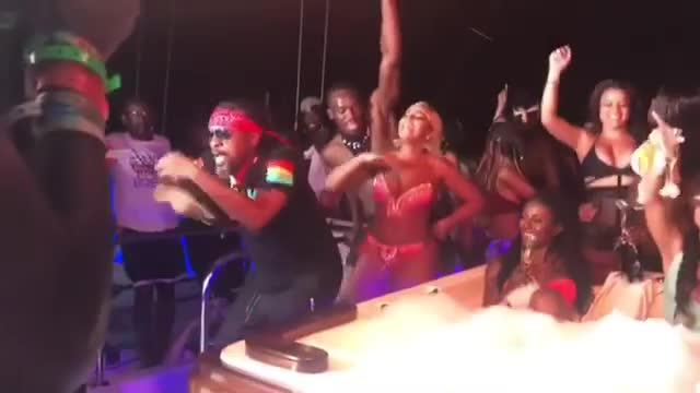 The R&B singer danced in front of the Jamaican sprint king at the Carnival