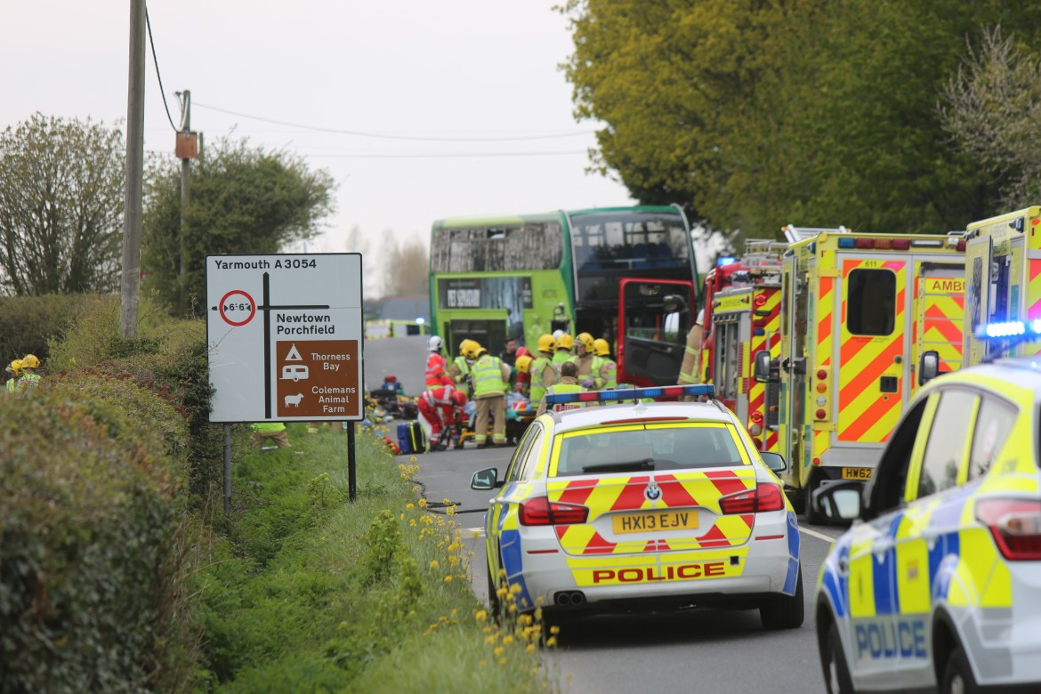The bus smashed into two cars on the Isle of Wight leaving at least 23 people injured