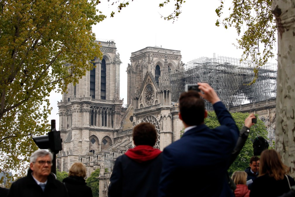 People gathered outside the cathedral to see the damage for themselves