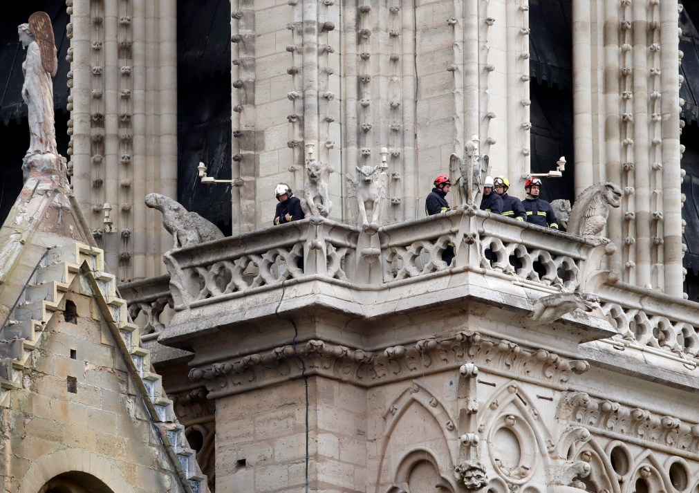 Firefighters look out from Notre Dame this morning