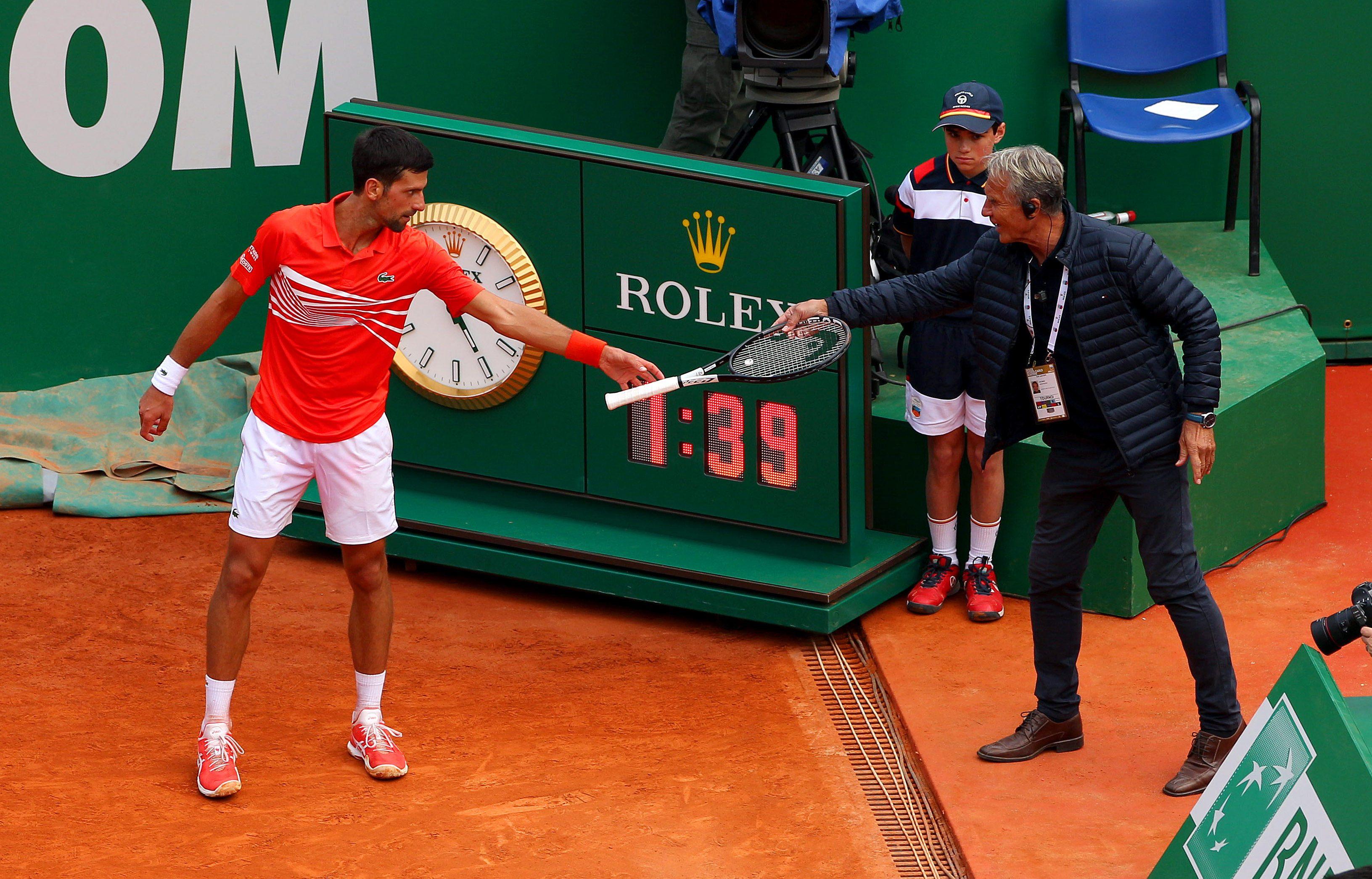 Djokovic is handed his racket back