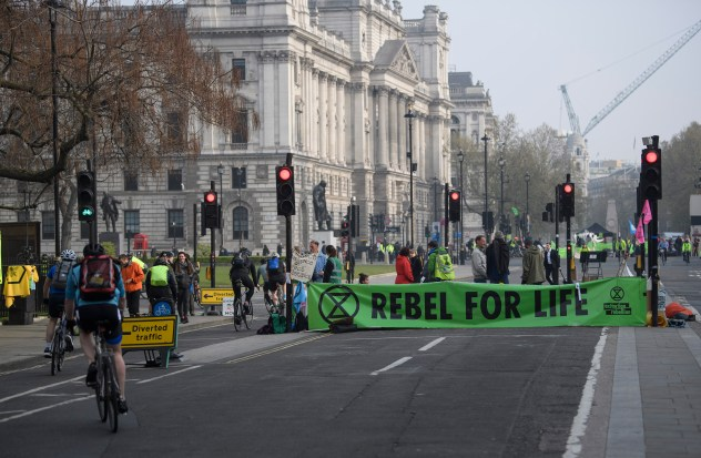 Roads empty of cars as Extinction Rebellion campaigners occupy Parliament Square in London on a fourth day of protests