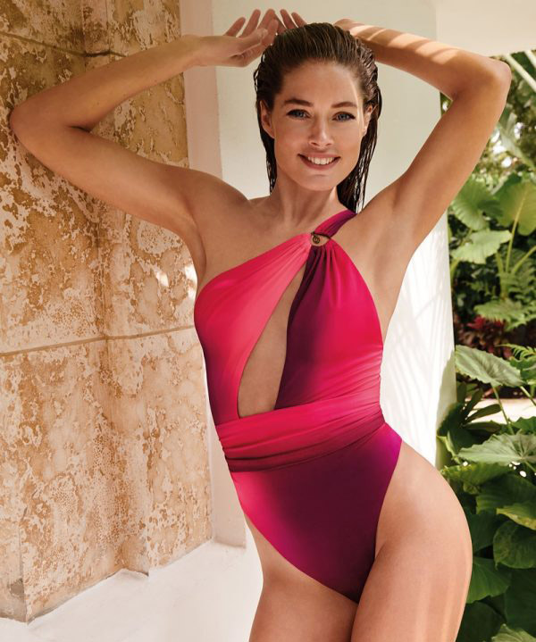 Doutzen Kroes stuns by the pool as she shows off her new swimwear range