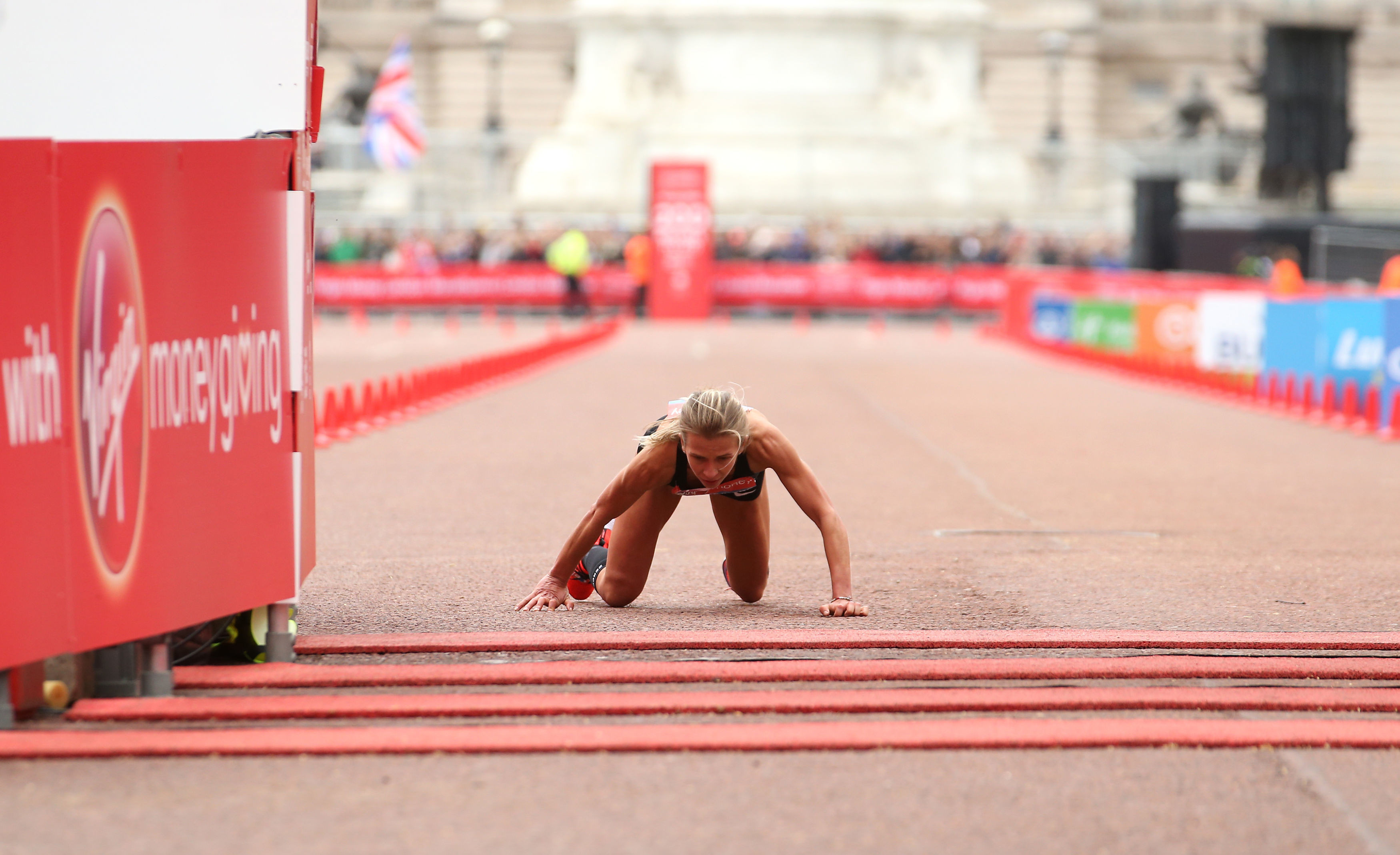 Hayley Carruthers collapsed and crawled across the finishing line