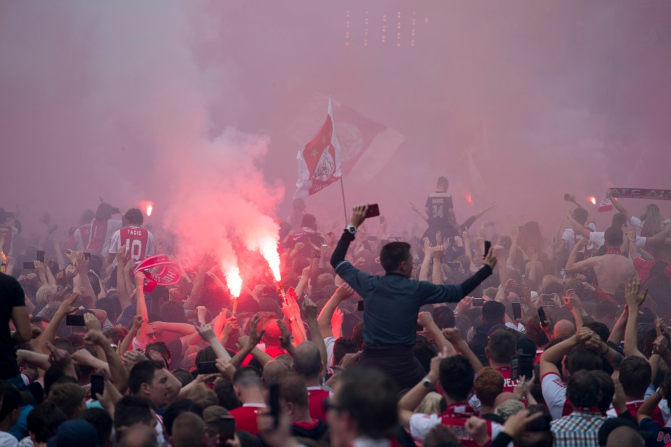 Supporters let of flares and waved their scarves and flags to welcome back their heroes