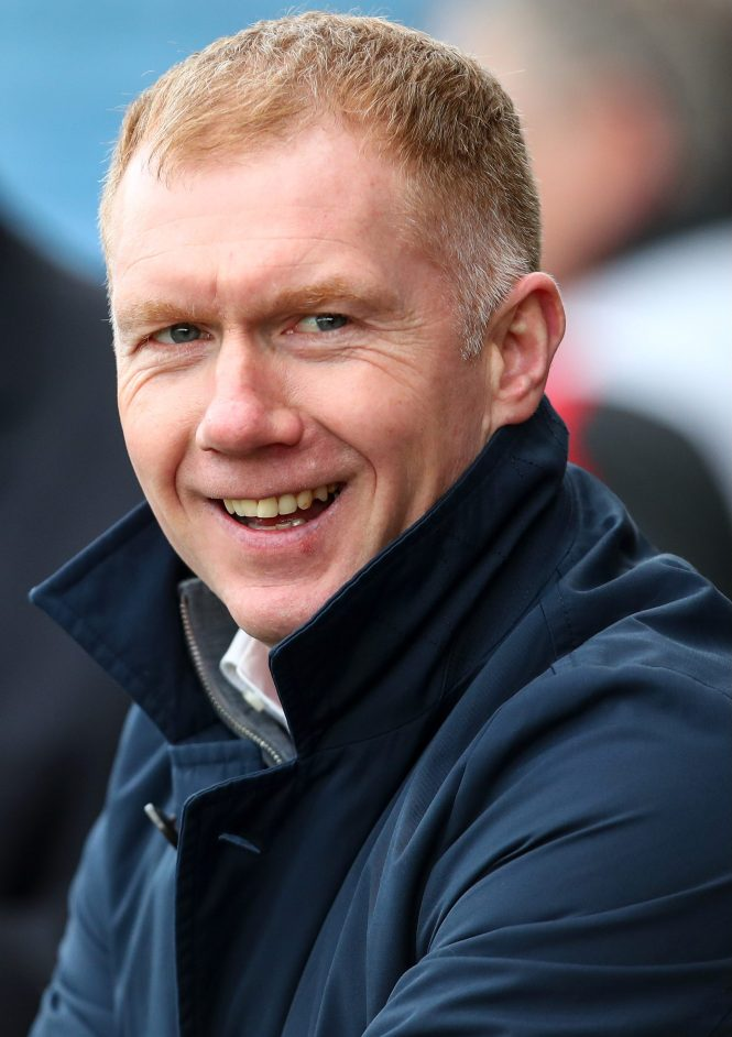 Old Trafford legend Paul Scholes sparked a social media exchange when he mocked his son for carrying their drinks over