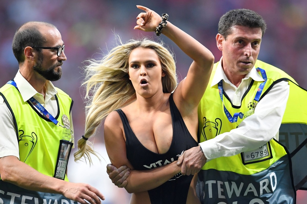 bbc4ed5ae1 Busty blonde pitch invader wearing tiny swimsuit stops Champions League  final and is escorted off by security
