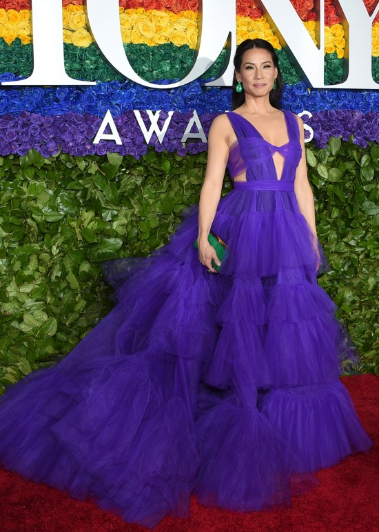 Lucy Liu also took the plunge in a stunning cutaway purple gown