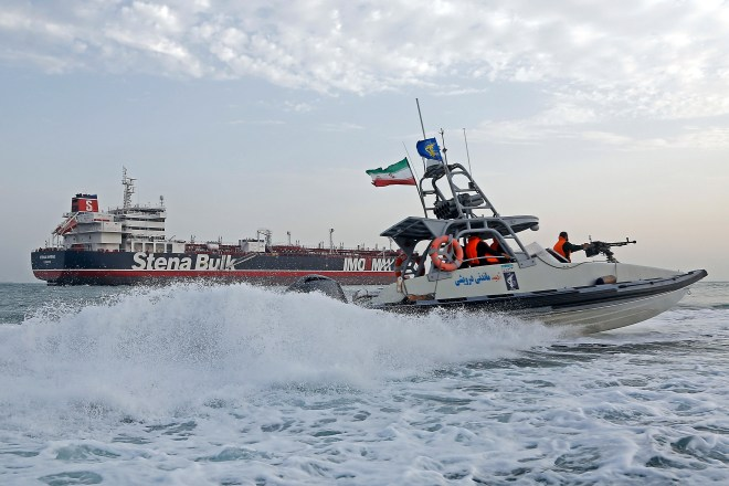 An Iranian Revolutionary Guard jet boat sails around the seized British-flagged tanker Stena Impero which was seized in July