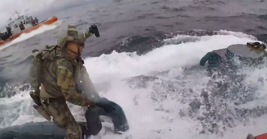 Three brave guardsmen jumped onto the moving narco-sub