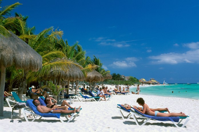 Holidaymakers in Cancun, which has been hit by the cyclsopora bug