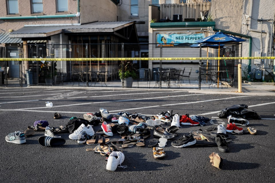 Shoes are piled outside the scene of a mass shooting where one of the locations was Ned Peppers bar