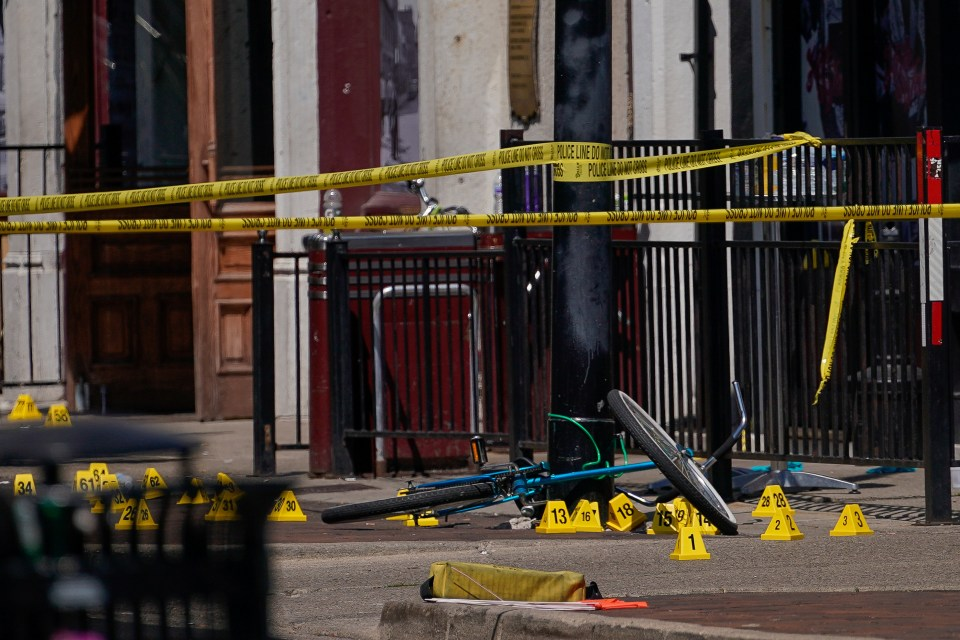 Evidence markers rest on the ground after the mass shooting in Dayton, Ohio