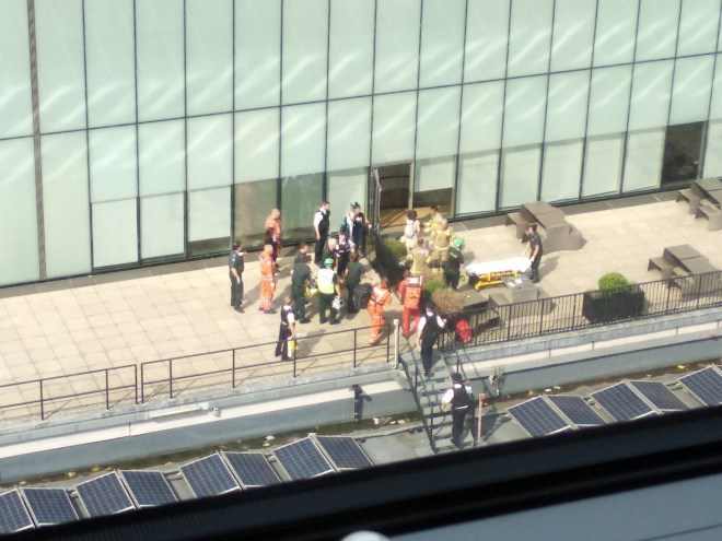 Emergency services tend to the boy on the 5th floor roof of the gallery