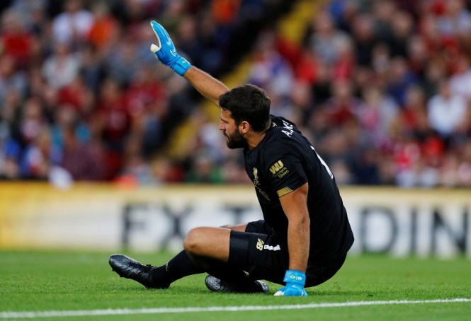 Alisson immediately called for assistance after the muscle injury