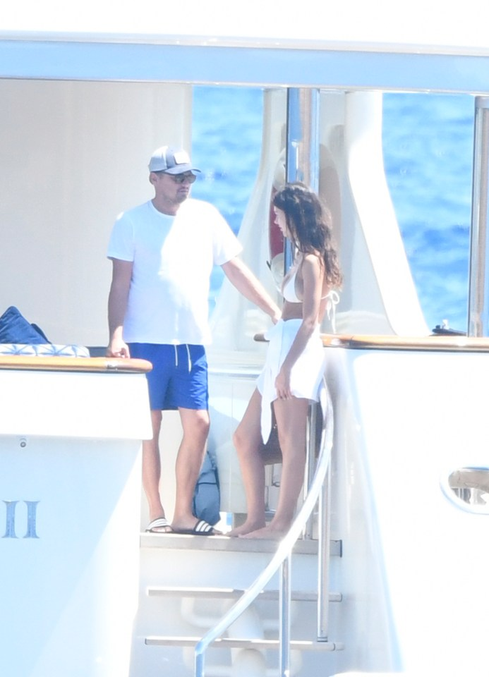 The Hollywood heartthrob and the brunette beauty gaze into each other's eyes on board a luxury yacht