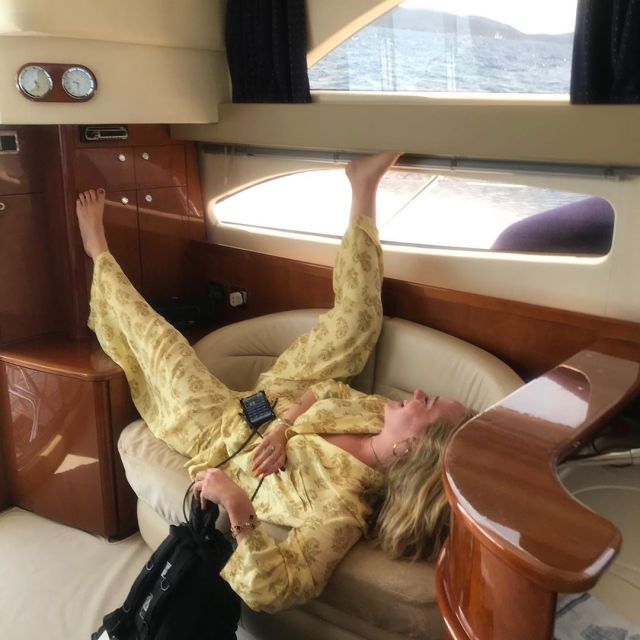 She threw her legs up in the air as she relaxed on a yacht