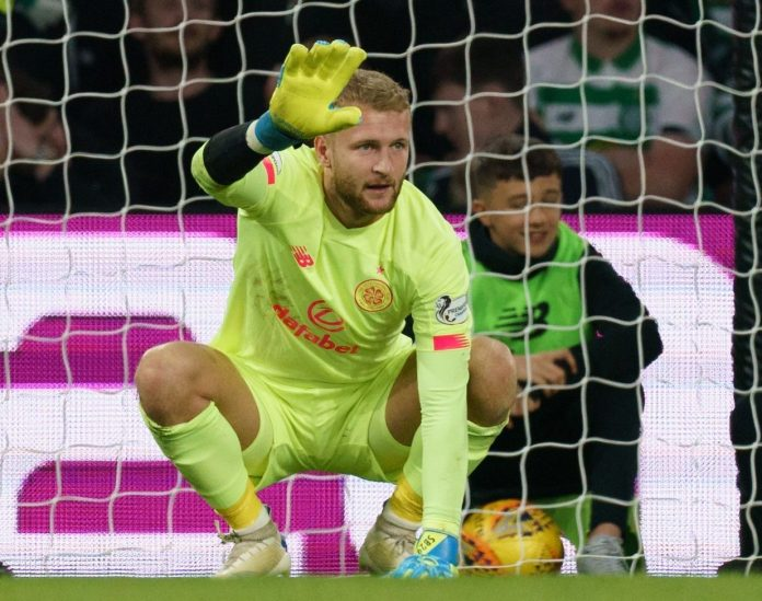 Scott Bain gestures to the Celtic bench against Cluj but finished the match despite his hand injury