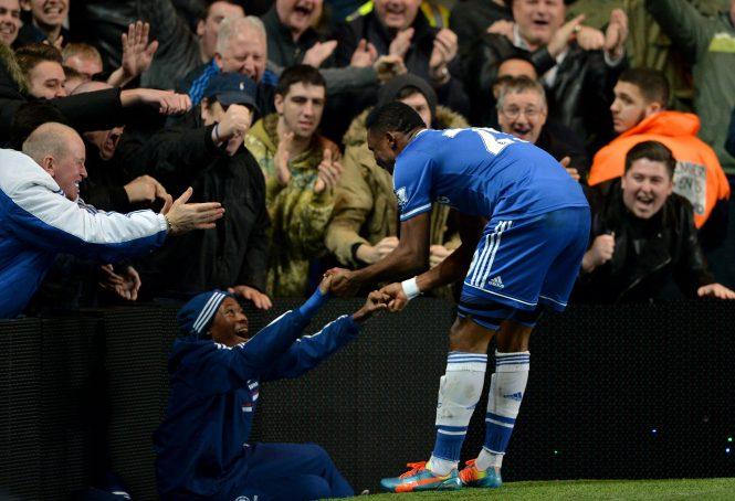 Samuel Eto'o celebrates with a 13-year-old Callum Hudson-Odoi who was a Chelsea ball-boy
