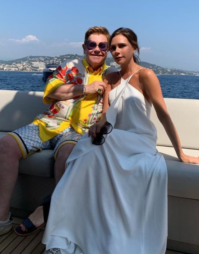 David and Victoria have been partying with Elton John