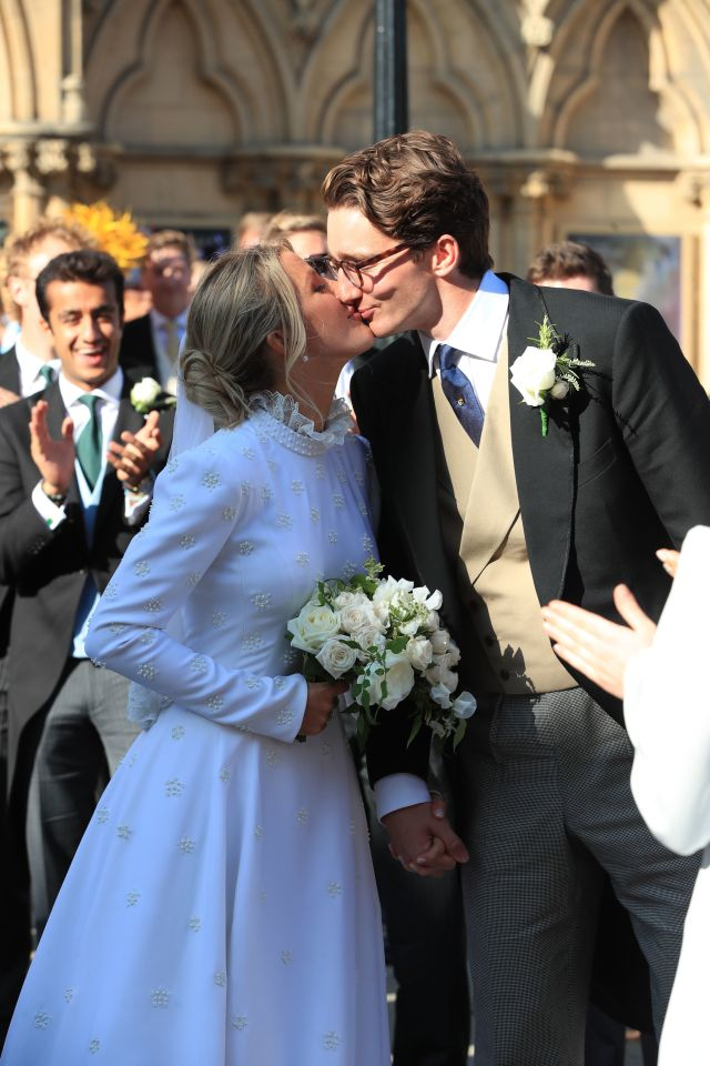 Ellie Goulding glowed with happiness as she shared a kiss with new husband Caspar Jopling