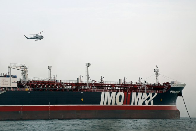 An Iranian Revolutionary Guard helicopter hovers around the seized British-flagged tanker