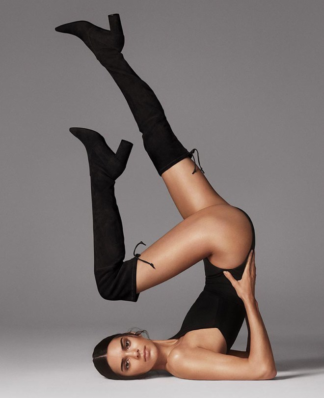 Kendall Jenner effortlessly posed upside down in a black leotard and over-the-knee boots