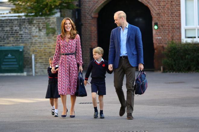 Kate held Charlotte's bad while Prince William held onto Prince George's