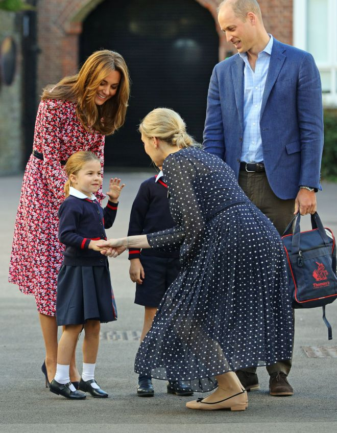 The four-year-old shakes the hand of Helen Haslem, Head of Lower School