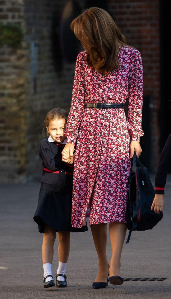 Princess Charlotte clutches mum Kate's hand