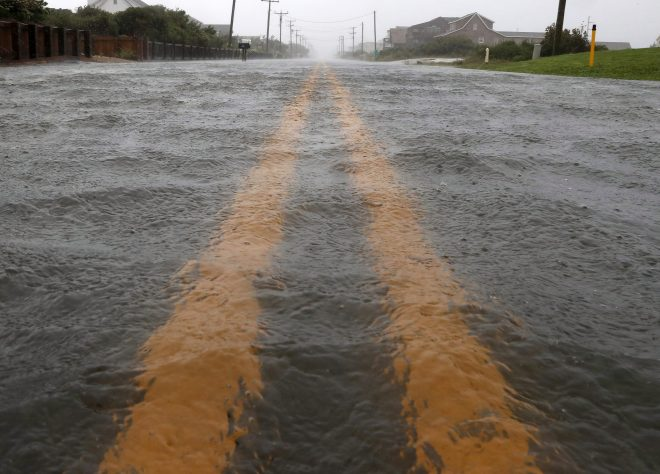 Water floods Highway 12 as Hurricane Dorian hits the area
