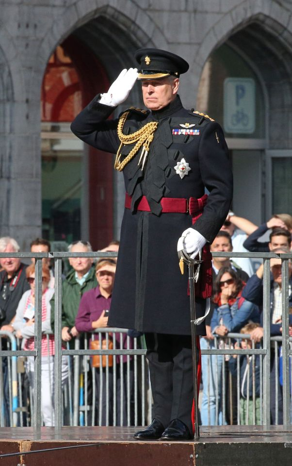 Prince Andrew salutes during the ceremony