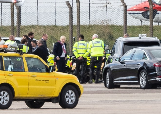Boris Johnson was pictured with security as he headed back to London
