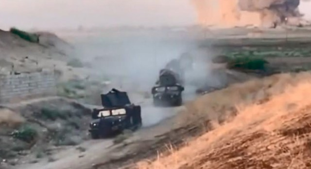 Coalition military vehicles are seen moving through the area in another part of the clip, which was released by the military yesterday