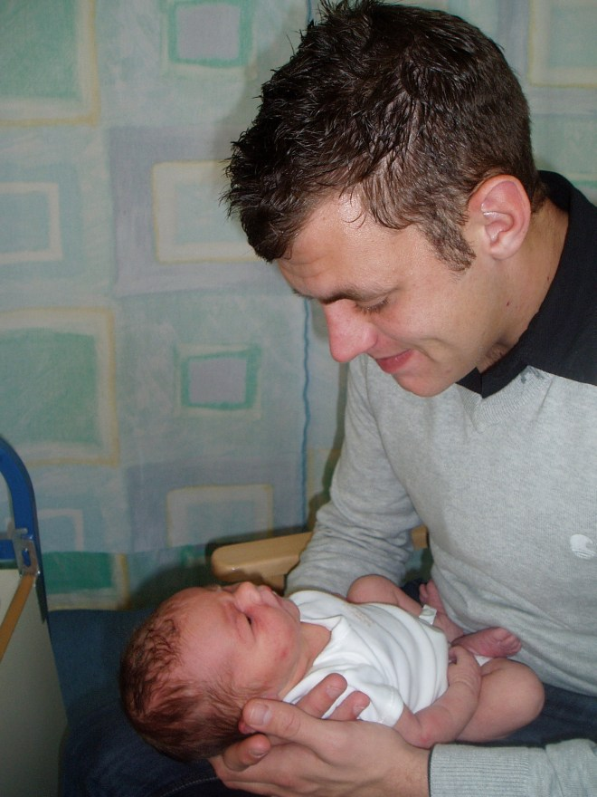 Corporal Lee Scott with his one-day-old daughter Brooke - he was killed when she was seven months old