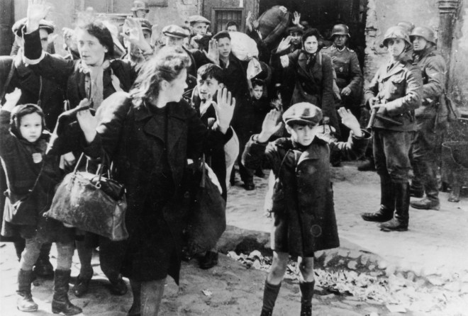 Jews from the Warsaw Ghetto surrender to German soldiers after a failed uprising
