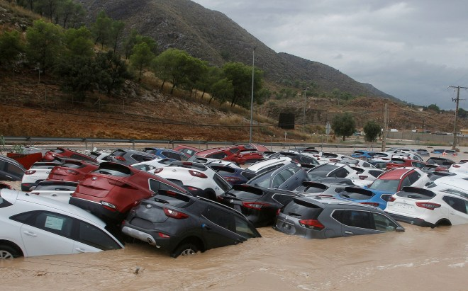 Cars piled up by floods in Orihuela