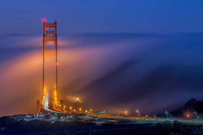 First prize in the cities and nature category is this image of Golden Gate Bridge engulfed in a wall of fog