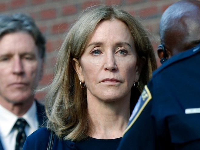 Felicity Huffman broke down in tears today as she was jailed for 14 days for her part in the college bribery scandal