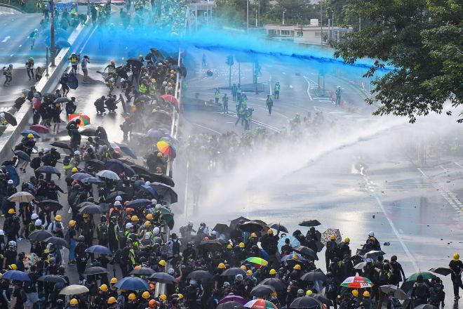 Cops fired blue dye at the crowds to make it easier to track down individuals later