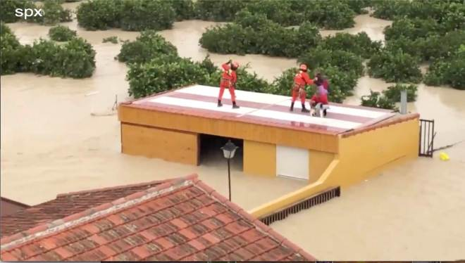Emergency services managed to help a person off the roof