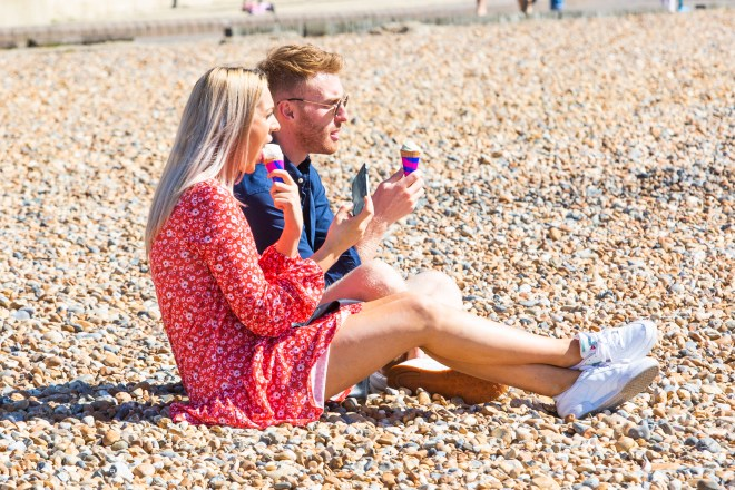 Beachgoers enjoyed ice creams in Brighton on Sunday