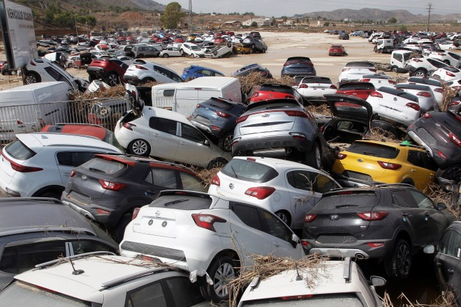 Vehicles ravaged by the floods are seen in Orihuela, Alicante